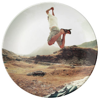 Man jumping from a rock porcelain plate