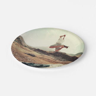 Man jumping from a rock 7 inch paper plate