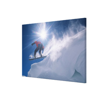 Man jumping off a large cornince on a snowboard canvas print