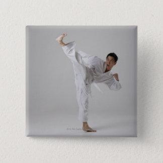 Man kicking high in the air, martial arts button