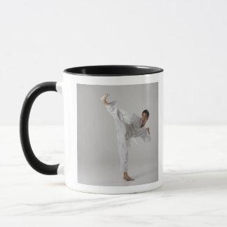 Man kicking high in the air, martial arts mug