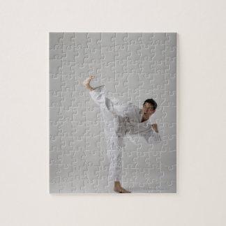 Man kicking high in the air, martial arts jigsaw puzzle