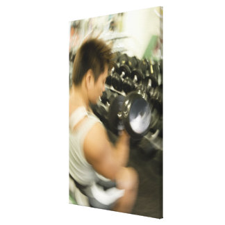 Man lifting dumbbell in gym, high angle view, gallery wrapped canvas