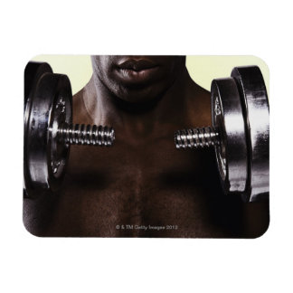 Man lifting dumbbells 2 rectangular photo magnet
