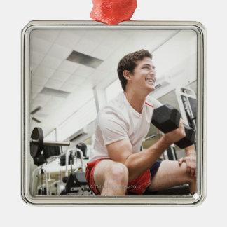 Man lifting dumbbells square metal christmas ornament