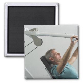 Man lifting weight at gym magnet