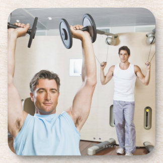 Man lifting weights at gym coaster