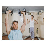 Man lifting weights at gym posters