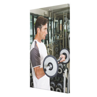 Man lifting weights in gym 2 gallery wrap canvas