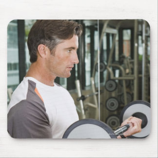 Man lifting weights in gym 2 mouse pads