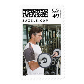 Man lifting weights in gym 2 postage stamps