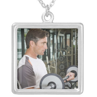 Man lifting weights in gym 2 silver plated necklace