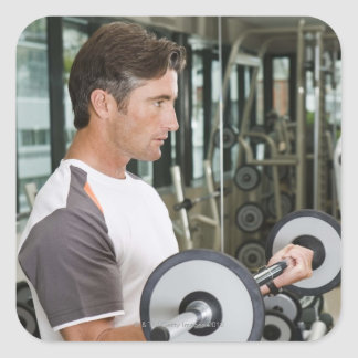 Man lifting weights in gym 2 square sticker
