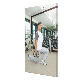 Man lifting weights in gym canvas prints