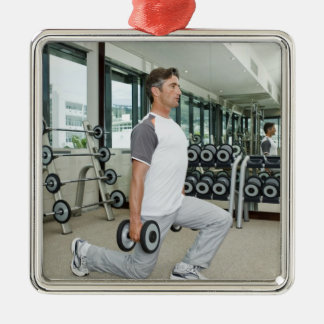 Man lifting weights in gym metal ornament