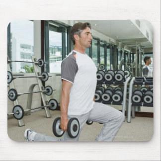 Man lifting weights in gym mouse pad