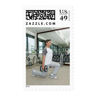 Man lifting weights in gym stamps