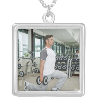 Man lifting weights in gym silver plated necklace