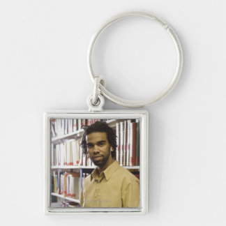 Man listening to music with headphones in keychain