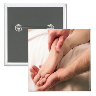 Man Massaging Male Foot 2 Inch Square Button