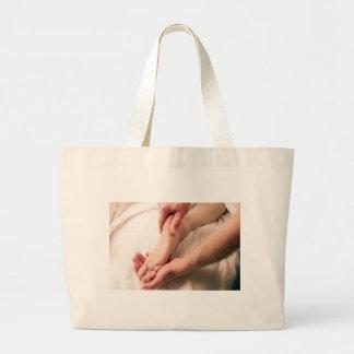 Man Massaging Male Foot Jumbo Tote Bag