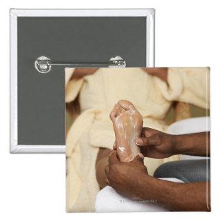 Man Massaging Woman's Foot Button