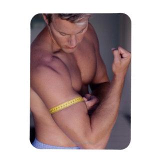 Man measuring bicep rectangular photo magnet