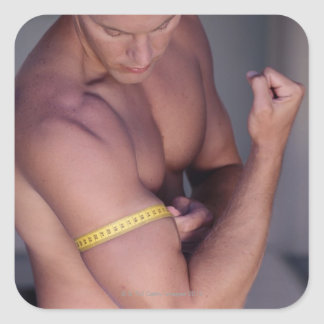 Man measuring bicep square sticker