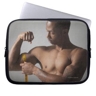 Man measuring his triceps laptop sleeves