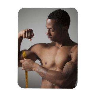 Man measuring his triceps magnet