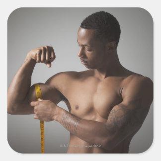 Man measuring his triceps square sticker