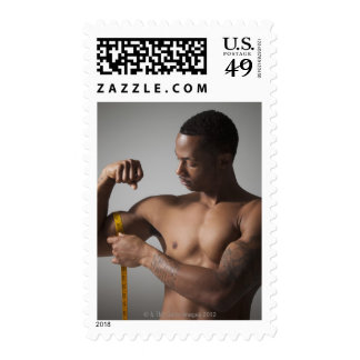 Man measuring his triceps stamps