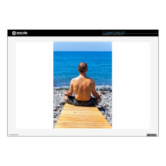"Man meditating at beach and sea skin for 17"" laptop"