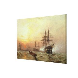 Man-o'-War firing a salute at sunset Canvas Print