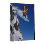 Man on a snowboard jumping off a cornice at iPad folio cover