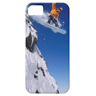 Man on a snowboard jumping off a cornice at iPhone 5 cases