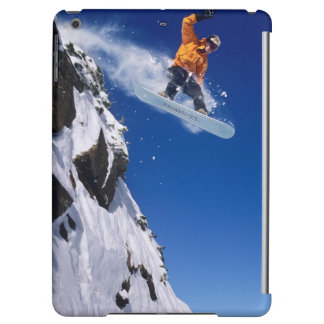 Man on a snowboard jumping off a cornice at cover for iPad air