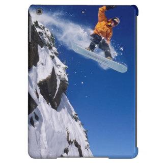 Man on a snowboard jumping off a cornice at iPad air case