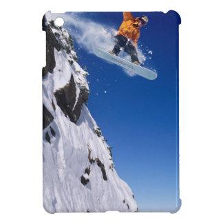 Man on a snowboard jumping off a cornice at iPad mini case