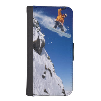 Man on a snowboard jumping off a cornice at iPhone 5 wallet