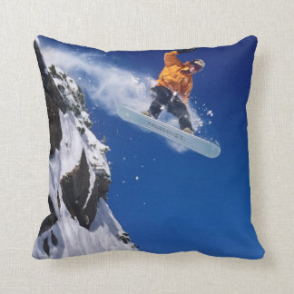 Man on a snowboard jumping off a cornice throw pillow