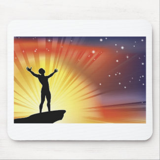 Man on cliff top with arms raised mousemat