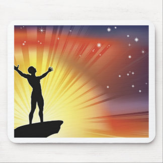 Man on cliff top with arms raised mouse pad
