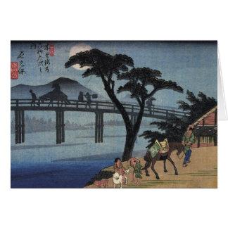 Man on horseback crossing a bridge card