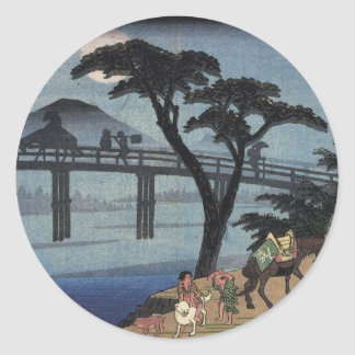 Man on horseback crossing a bridge classic round sticker
