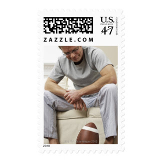 Man on Sofa with Football Postage
