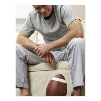 Man on Sofa with Football Postcard