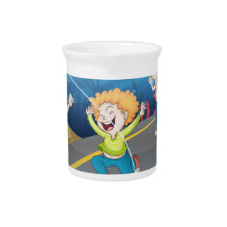 Man painting picture on canvas beverage pitcher