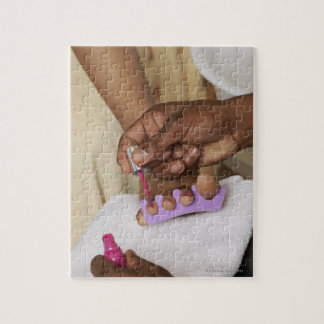Man Painting Woman s Toes Puzzles