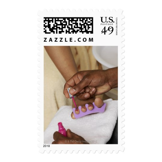 Man Painting Woman's Toes Postage